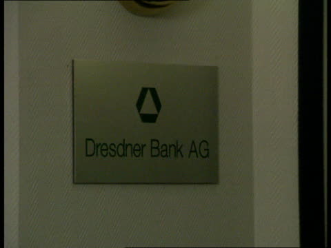 dresden ext traffic along dual carriageway/ smoke from industrial plant/ more of traffic/ ext plant int dresdner bank/ people in waiting room/ logo... - dresdner bank stock videos and b-roll footage