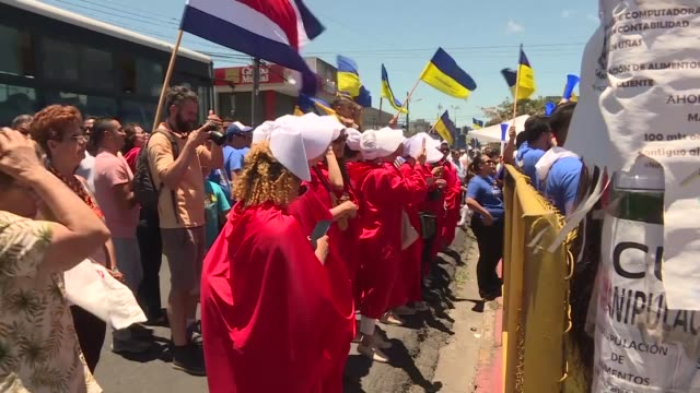dressed as the red and white handmaids from margaret atwood's novel the handmaid's tale costa rican women protest against fundamentalism in front of... - fundamentalism stock videos & royalty-free footage