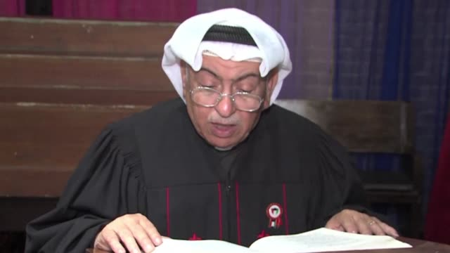 dressed in a traditional white gulf headdress and with two red crosses embroidered on his black clerical robe kuwait's first homegrown priest cuts a... - headdress stock videos & royalty-free footage