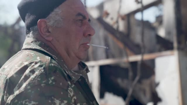 dressed in military fatigues, the mayor of martakert misha gyurjyan leans on his desk topped with coils of cables and two landline telephones in a... - landline phone stock videos & royalty-free footage
