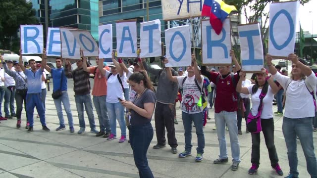 Dressed in white and carrying signs with slogans like recall now thousands of Venezuelans begin a demonstration Thursday in Caracas demanding a...