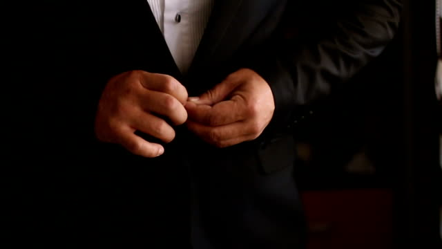 dressed man buttoning his suit jacket - suit jacket stock videos & royalty-free footage