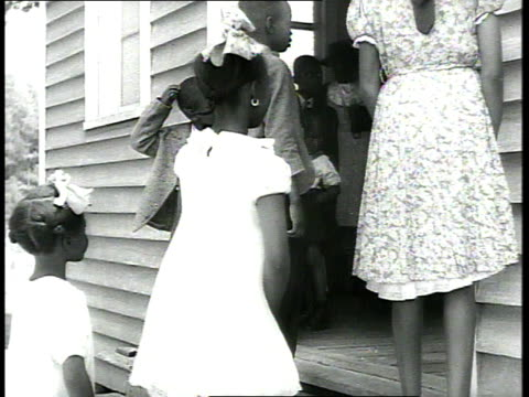1939 ms dressed-up children entering church - unfairness stock videos & royalty-free footage