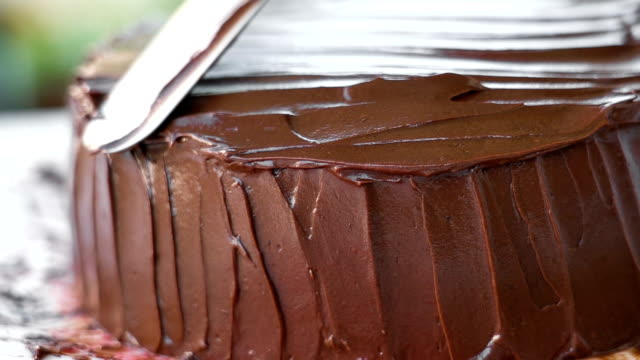 slo mo dressing chocolate cake. - cake stock videos & royalty-free footage