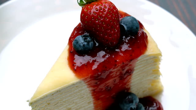 dressing crepe cake with stawberry sauce and fresh stawberry, blueberry on top - lunch stock videos & royalty-free footage