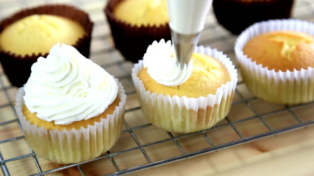 dressing cupcake - cupcake stock videos & royalty-free footage