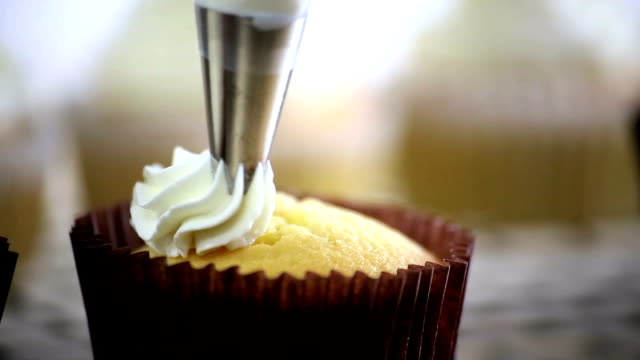 dressing cupcake - bakery stock videos and b-roll footage