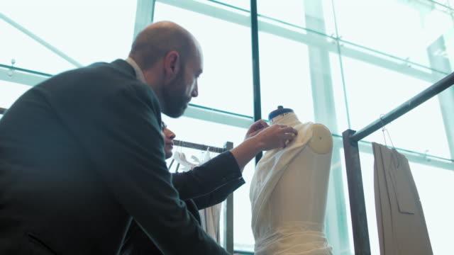 dressing dressmaker's model - トルソー点の映像素材/bロール
