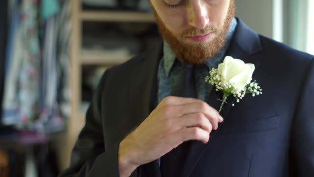 dressing for wedding - best man stock videos and b-roll footage