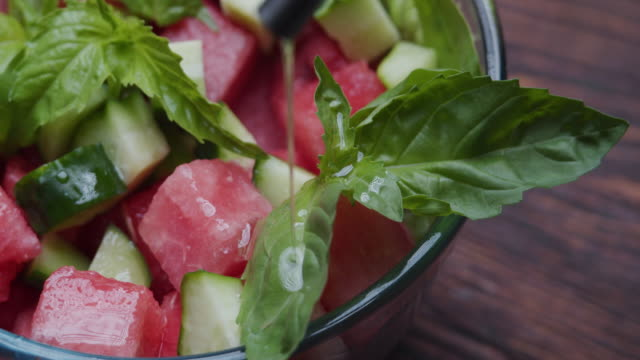 dressing fresh salad with watermelon, spinach, cucumber and basil - spinach salad stock videos & royalty-free footage