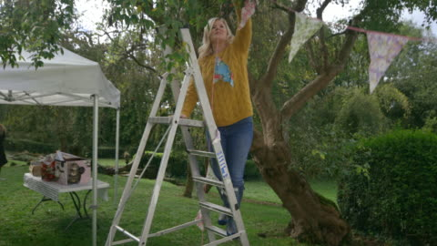 dressing the garden - decoration stock videos & royalty-free footage