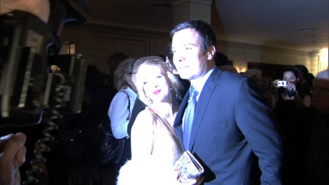 drew barrymore & jimmy fallon posing together in crowded pierre hotel lobby for press photographs, bright flashes, photographer fg . - ドリュー・バリモア点の映像素材/bロール
