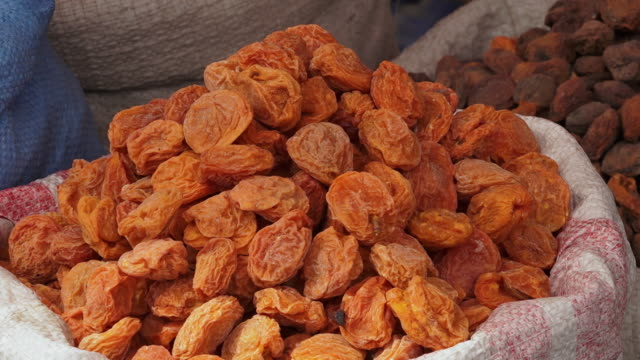 dried apricot fruits at a market, kargil, india - dried food stock videos & royalty-free footage