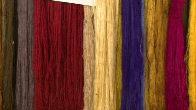 dried fine silk threads in bright, vivid colours - ball of wool stock videos & royalty-free footage