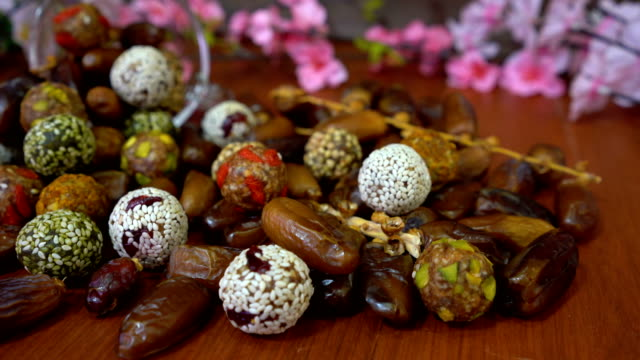 dried fruit , date fruit , date ball with cereal - arabic script stock videos & royalty-free footage