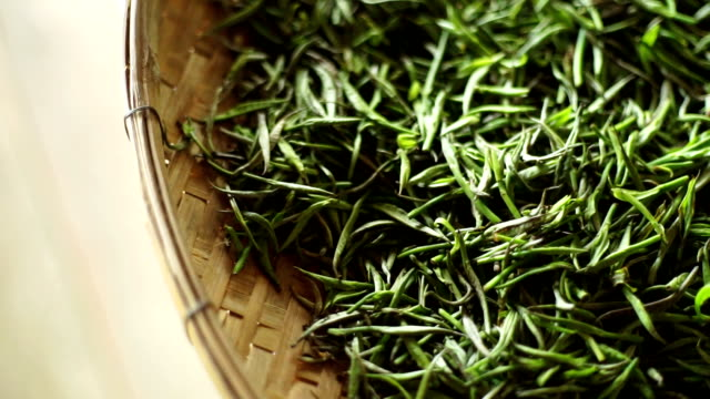 dried green tea process in basket. - dried tea leaves stock videos & royalty-free footage
