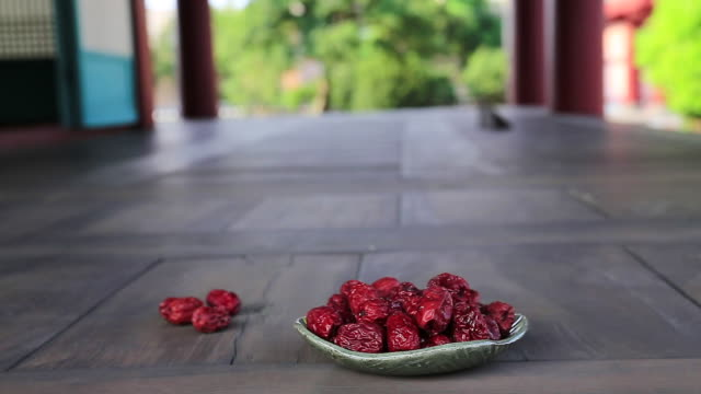MS Dried jujube on wooden floor in Traditional Korean House / Jeju, Jeju-do, South Korea