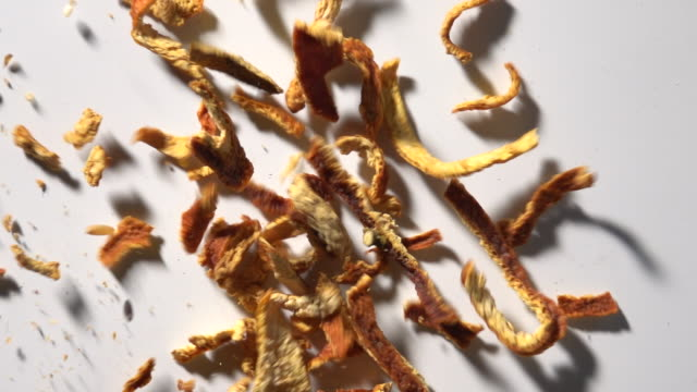 dried orange peel in slow motion with white background - skal plantdel bildbanksvideor och videomaterial från bakom kulisserna