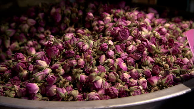 CU ZI Dried pink roses in bowl on bazaar, Isfahan, Iran