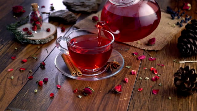 dried rose herbal tea on wooden background - tea cup stock videos & royalty-free footage