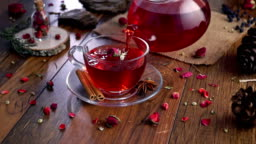 Dried rose herbal tea on wooden background