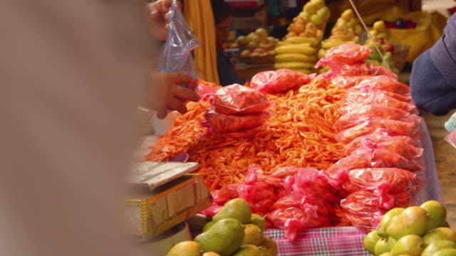 dried shrimp stall in a street market in san cristobal de las casas, mexico - テナガエビ点の映像素材/bロール