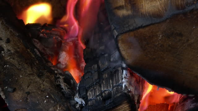 cu dried wood burning in open fire - wood material stock videos & royalty-free footage