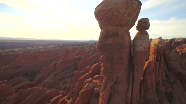 drift past the tower arch at the arches national park - arches national park stock videos & royalty-free footage