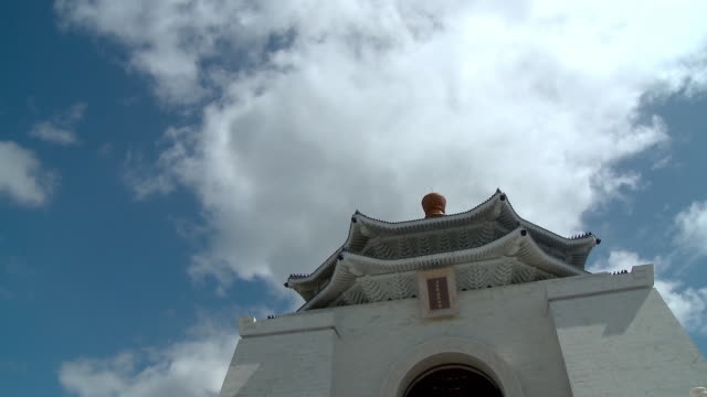 drifting clouds in the sky pass over chiang kai-shek memorial hall. - chiang kaishek memorial hall stock videos & royalty-free footage
