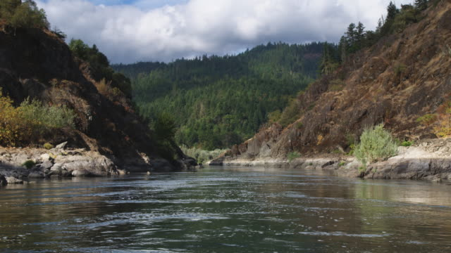 drifting through a narrow section of the rogue river canyon, oregon - riverbank stock videos and b-roll footage