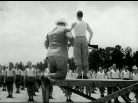 drill instructor on platform w/ british prime minister winston churchill climbing up standing behind di pan ms soldiers exercising w/ rifles barracks... - drill instructor stock videos & royalty-free footage