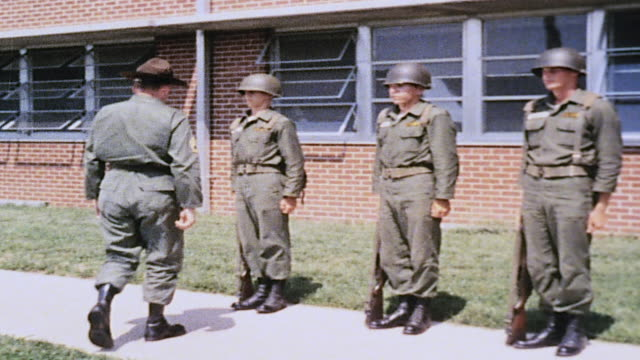 drill sergeant inspecting recruits' uniforms on parade ground / fort leonard wood missouri united states - sergeant stock videos & royalty-free footage