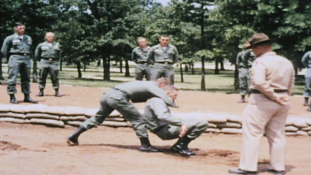 ws drill sergeant observing as recruit displays one method of handtohand combat / fort leonard wood missouri united states - drill instructor stock videos & royalty-free footage