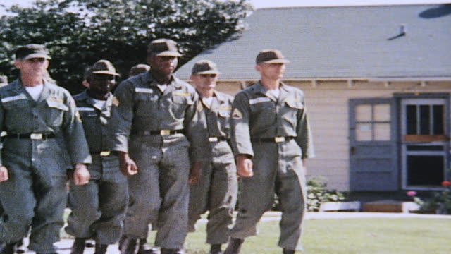 ts drill sergeants marching in formation at drill sergeant school unit passing sign for the school / fort leonard wood missouri united states - sergeant stock videos & royalty-free footage