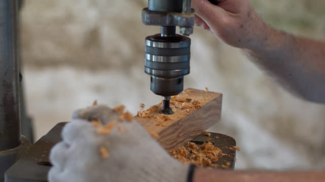 drill wooden board with machine - carpenter stock videos and b-roll footage