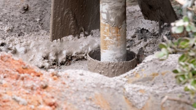 drilling a borehole is dirty work - well structure stock videos and b-roll footage