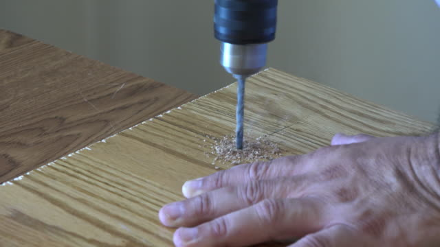 diy: drilling a hole on a piece of wood - hot desking stock videos & royalty-free footage