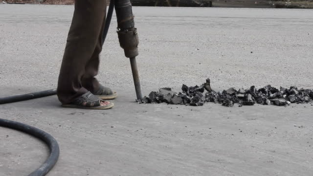Drilling asphalt road.