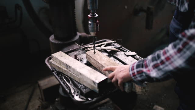 drilling at workshop with manual control - steel stock videos & royalty-free footage