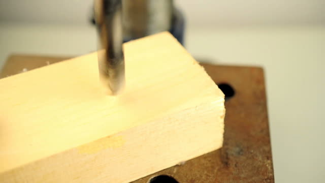 drilling in to wood board - drill bit stock videos and b-roll footage