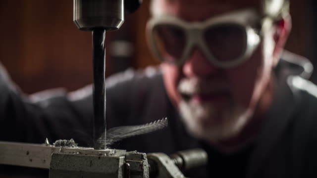 drilling machine - slow motion - drill bit stock videos and b-roll footage