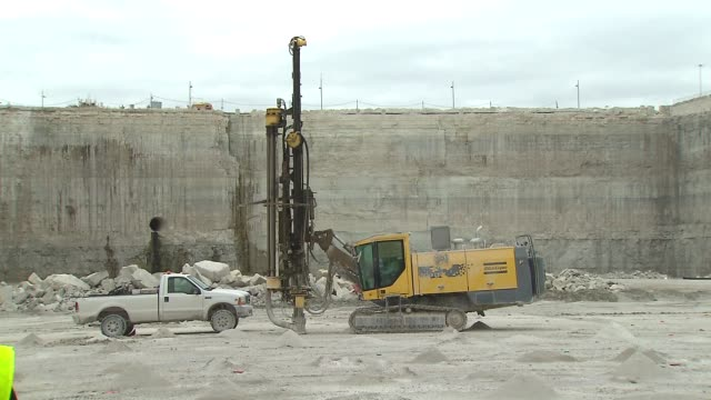 wgn drilling machines at mccook quarry in chicago on may 13 2015 - stone material stock videos & royalty-free footage