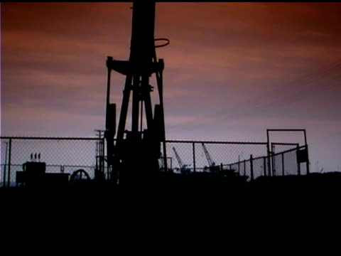 drilling pumpjack back lit - back lit video stock e b–roll