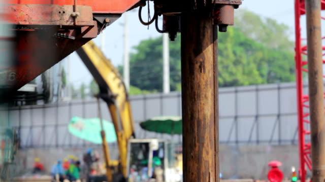 Drilling soil machine on Construction site,Tilt down shot