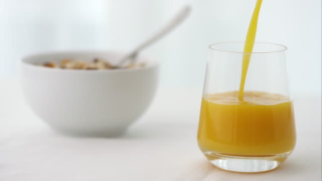 drink being poured into glass at breakfast time - orange juice stock videos & royalty-free footage