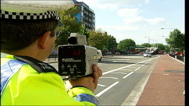 metropolitan police launch summer campaign england ext police officers using speed guns police officers carrying out breathalyzer tests - alkoholtest stock-videos und b-roll-filmmaterial