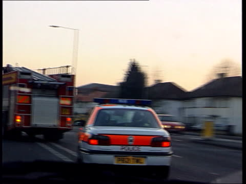 drinkdrive limit to be lowered cs man blowing into breathalyser cs indicator light on breathalyser with red fail light on ms two policemen sitting in... - alkoholtest stock-videos und b-roll-filmmaterial