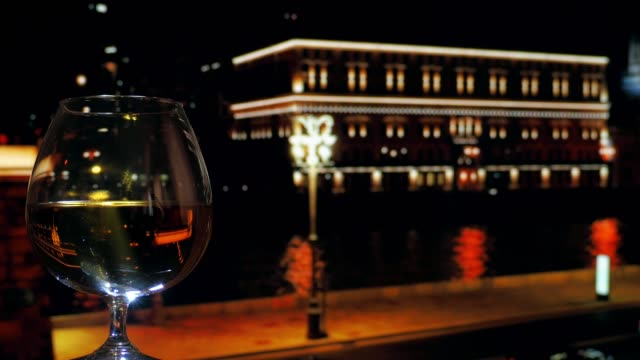 drinking brandy in night city - brandy snifter stock videos and b-roll footage