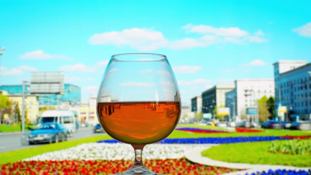 drinking brandy in the city - brandy snifter stock videos & royalty-free footage