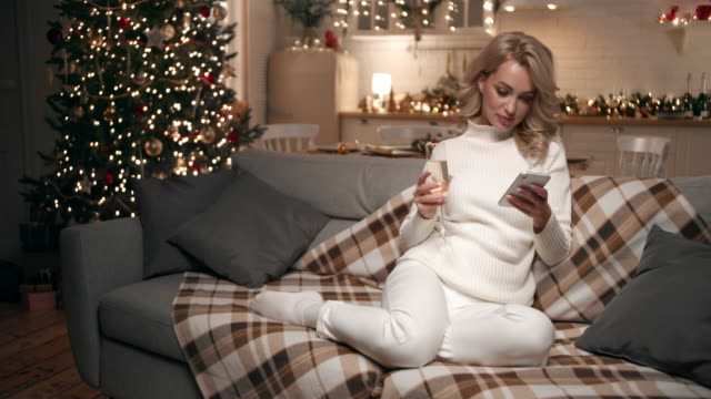drinking champagne and thinking about christmas - champagne stock videos & royalty-free footage